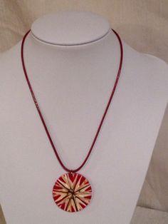 Sunburst medallion necklace.