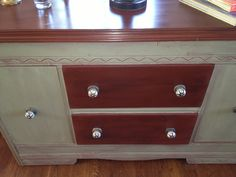 Vintage buffet in Annie Sloan Primer Red and Chateau Grey.  This was in such sad shape when I first got her, but she's gorgeous now and is in her forever home loving all the attention she gets.