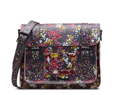 Our vintage-inspired 11 inches satchel is crafted from a hardwearing, premium leather and features adjustable straps, buckle fastening and metal hardware, finished with a handy pocket and metal Dr. Martens brand label. This exclusive Floral Clash print is part of a collection of footwear and accessories. 11 inches wide x 8 inches tall and 3 inches deep, shoulder strap 45 inches.
