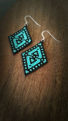 Made with Delica seed beads on sterling silver hooks. Brickstich. Native American.