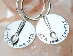 This fun set of Big To My Little and Little To My Big key chains comes decorated with spoon charms. Set on an 18-gauge aluminum 1 disc, this is a perfect gift set for you and your snuggle partner to share. Through First Class Shipping (3-5 days), this item ships free! Expedited shipping available.  At Charmed Olive, each letter is individually hand stamped.