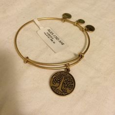 Alex & Ani Gold Tree of Life Bangle Brand New With Tag! ⛔️ NO TRADES, NO PAYPAL, NO MERCARI, NO HOLDS ⛔️ smoke free, pet free home  let me know if you have other questions  PLEASE MAKE OFFERS THROUGH THE OFFER BUTTON. Alex & Ani Jewelry Bracelets