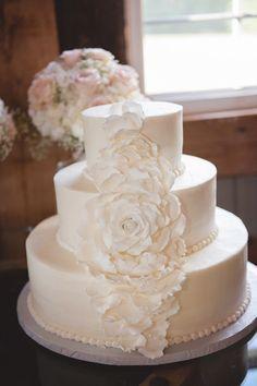 Classic wedding cake idea - three-tiered, fondant-frosted wedding cake with sugar flower decor {Allison Kuhn Creative}