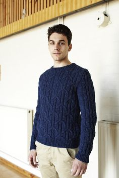 """Yabane is inspired by a traditional Japanese arrow feather pattern (""""yabane""""). The body of this sweater is worked seamlessly in circular knitting in one piece to the underarms. Front and back are worked separately above underarms. A circular needle is used to accommodate the large number of stitches. Sleeves are worked separately and attached at the end. Collar stitches are picked up and knitted once back and front are joined at the shoulders.The sample was knit in Artesano Aran. A…"""