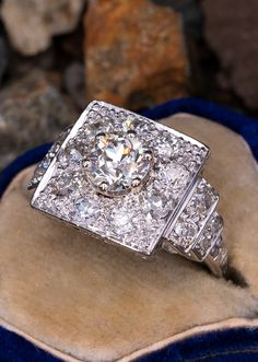 This incredible circa ring is centered with a round old European cut diamond weighing carats set into a six-prong head. The center diamond is surrounded by nine bead set, old European cut diamonds. The shoulders of the ring are each accented wi Diamond Gemstone, Diamond Rings, Diamond Cuts, Gemstone Rings, 1920s Ring, Garnet Jewelry, European Cut Diamonds, Heart Ring, Jewelery