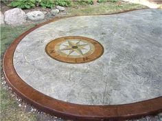 Stamped concrete patio features a custom colored compass.  Featured 10/25/12. John's Cement Milford, MI