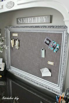 Framed fabric bulletin board , I like the color tones used here, especially the fabric against that frame.