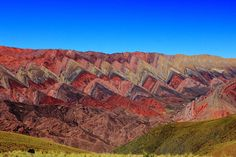"Serrania de Hornocal mountains - Quebrada de Humahuaca - photo by Lahi, via Wikipedia;  near the city of Humahuaca, Jujuy province, Argentina;  a limestone mountain range ""with various minerals which ..., after tectonic activity and erosive process, multicolored triangular formations"""