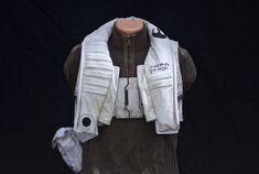 This is the finished product of Poe Dameron's flight vest from Star Wars: Force Awakens. I patterned and sewed it from the ground up, using my duct tape mannequin as a form. Most of the vest...