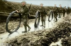 WW1. British troops taking rolls of barbed wire to the Front line at the Somme in 1916. Colour by Callan Chevin.