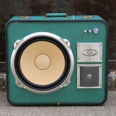 Vintage Aeropak green case with a mid 1980's Sansui 3-way speaker system and dome tweeter