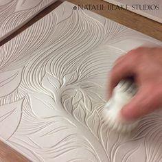 Natalie cleaning off tiles before glazing them . . . handmade hand carved botanical porcelain tiles . . .