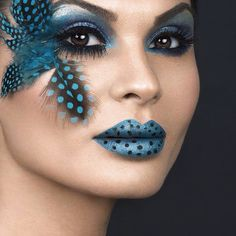 Chic blue polka dot makeup art with black and blue dotted feathers and polka dotted lips created with blue lipstick.