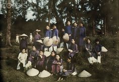 ca. July 1930, Hue, Annam, French Indochina --- An informal group portrait of Hue schoolgirls on a picnic --- Image by © W. Robert Moore/National Geographic Society/Corbis by abcd1799, via Flickr