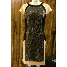 NWT Black & Tan Dress A great, slightly body con dress with colorblock panels. Stretch fabric except for front- Front is faux leather with laser cutout pattern. True black & light tan colors. Tried on & very flattering, but Never worn!! Dresses Mini