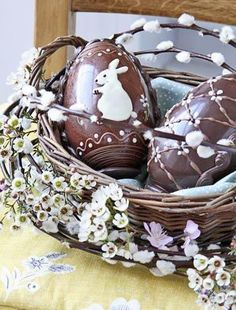Decorate a wicker basket with blossom and pussy willow, then fill with eggs - chocolate eggs make for a delicious treat!