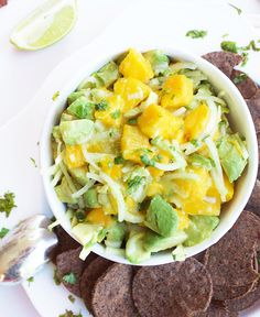Mango and Avocado Ceviche l The Simple Kitchen || Ceviche made with mango, avocado and onions marinated with limes, cilantro and olive oil. A nice vegan twist on this classic fish dish!
