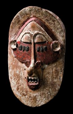 Africa | Mask from the Lula people of DR Congo | Wood, pigment || The mask style of the Lula is very similar to that of the neighbouring Holo, Zombo, Nkanu and Soso. These masks were used to protect initiates of witches and sorcerers.