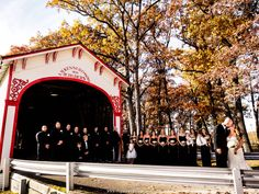 Wedding party at Lake County Fairgrounds by the old covered bridge.