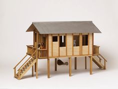 Guyanese dolls' house- what a great garden playhouse this would make, on a larger scale. Doll Museum, V & A Museum, Play Houses, Bird Houses, Garden Playhouse, Kensington And Chelsea, Old Pallets, The V&a, Modern Dollhouse