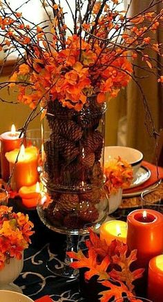 Thanksgiving decorations - Leaves and orange candles make for the perfect intimate Thanksgiving table setting. Thanksgiving decorations - Leaves and orange candles make for the perfect intimate Thanksgiving table setting. Fall Crafts, Holiday Crafts, Fall Table Centerpieces, Fall Table Decorations, Table Arrangements, Diy Thanksgiving Centerpieces, Wedding Centerpieces, Thanksgiving Tablescapes, Centerpiece Ideas
