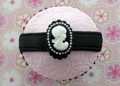 Black & Pink Embossed Cameo Cupcakes https://www.facebook.com/notes/victorious-cupcakes/how-to-make-victorian-cupcakes-with-victoria-and-goodtoknow/235817903100438