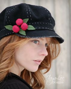 Black Cherry Newsboy Hat by Jaya-Lee Designs. This hat is made from thick black wool fabric (feels almost like felt). The crown, band, and