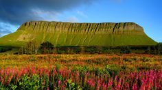 Ireland - Ben Bulben, sometimes spelt Benbulben or Benbulbin (from the Irish: Binn Ghulbain), is a large rock formation in County Sligo, Ireland. It is part of the Dartry Mountains, an area sometimes called 'Yeats Country'.  Photography by Chris Hill.