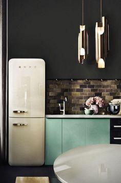 stunning dark kitchen with skinny retro fridge and turquoise cabinets