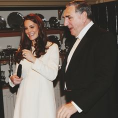 Thursday, 12 March 2015 The Duchess of Cambridge visited the set of the ever-popular drama series Downton Abbey this morning. Cream coat by Jojo Maman Bebe Pretty sure she was fangirling in this photo. I would be, too.