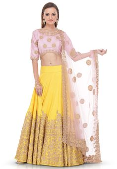 Pure silk lehenga in yellow This hand embroidered readymade attire is designed with zari work As shown, a pink pure silk choli and a pink net dupatta is available The lehenga lenght is 40 inches Do note: Accessories shown in the image are for presentation purposes only.(Slight variation in actual color vs. image is possible)
