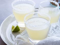 Real Margaritas : Ina Garten  1 lime, halved Kosher salt 1/2 cup freshly squeezed lime juice (5 limes) 2 tablespoons freshly squeezed lemon juice (1 lemon) 1 cup Triple Sec 1 cup white tequila 2 cups ice (if frozen)