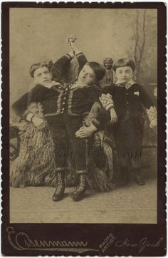 Original c.1890 cabinet card photo of The Tocci Brothers, Italian born conjoined twins. Here they are shown in a photo studio with their brother.