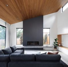 Home Remodel Modern This room is blessed with high ceilings so is perfect for timber providing a wonderful contrast to the grey and granite. Home Fireplace, Living Room With Fireplace, Fireplace Design, Modern Fireplaces, Black Fireplace, Timber Ceiling, Wooden Ceilings, Wooden Ceiling Design, Modern Ceiling