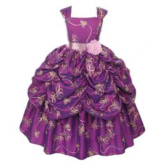 Your little girl will look amazing in this special occasion pageant dress by Kiki Kids. This stylish eggplant dress features floral embroidered taffeta and a pick up skirt. It is embellished with a sash and a flower at waistline. It has a ribbon bow at ba