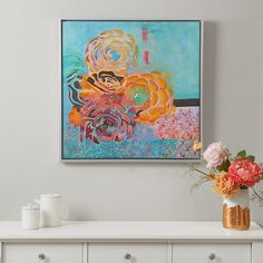 "Bring style and a touch of sweetness with Bohemian Posies Aqua, a framed hand embellished canvas. This piece features blossoming flowers with a vibrant color palette. This 30x30"" piece by artist Jeanne Wassenaar will be a colorful and beautiful choice for your home."
