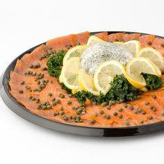 Smoked Salmon Tray - Two pounds of thinly sliced, smoked Atlantic Salmon rolled and placed around a cream cheese centerpiece with capers and dill. See our Casual Catering Menu for more ways to enjoy your next gathering!