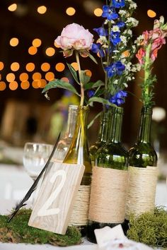 Light Barn Twine Wrapped Wine Bottles Wedding Centerpiece / http://www.deerpearlflowers.com/rustic-barn-wedding-ideas/2/