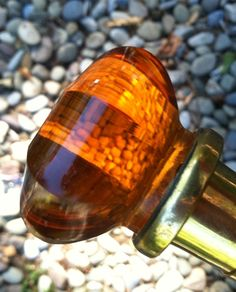 Vintage Amber glass top carved walking cane with carved detail.