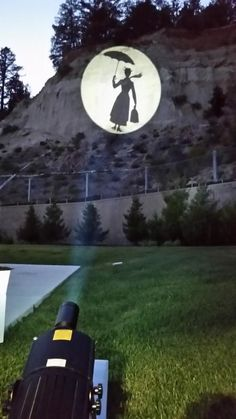ECO Spot LED B150 projecting a 33ft large image at 130ft distance at dusk onto a mountain slope. The image size can easily be more than doubled when  it gets darker.