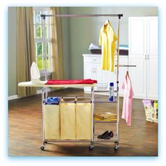 Mobile Ironing Station. Just wheel it where you need it! Features ironing board and rest, TWO hanging bars,3 shelves and triple hamper sorter. Available at LaundryShoppe.com