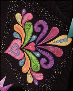 Here's a close-up of some of Nancy's beautiful machine embroidery applique work on the corner embellishments of the Sedona Star pattern.