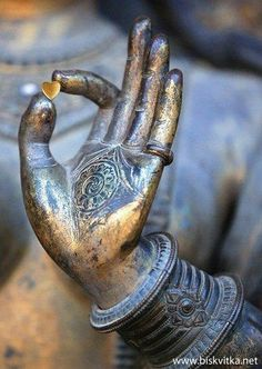 <3 little golden heart in buddhist statue's hand