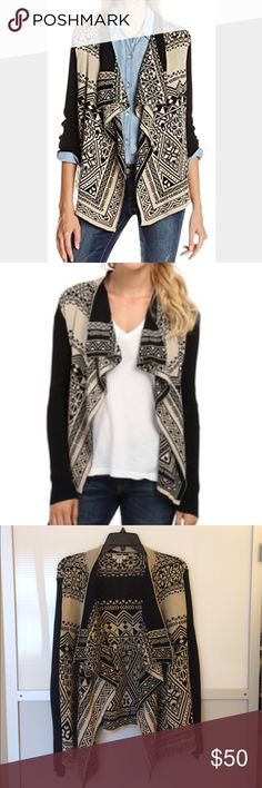 Lucky Brand Aztec Print Waterfall Cardigan Beautiful Lucky Brand Cardigan with black and  tan geometric/Aztec print and black ribbed sleeves. Draped open front, 100% cotton. Length of back is about 22.5 inches, longer on sides. Has been worn/washed several times but in EUC! Lucky Brand Sweaters Cardigans