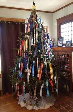 You know you're a runner if you decorate your Christmas Tree with race medals. -- MY NEW GOAL!! I have enough for a small tree. Guess it's time to sign up for more races!