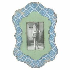 """Display cherished family memories with this vintage-inspired picture frame, showcasing a quatrefoil motif in green and blue.  Product: Picture frameConstruction Material: Engineered woodColor: Green and blueFeatures: Holds one 4"""" x 6"""" photoDimensions: 14"""" H x 10"""" W x 1"""" D"""