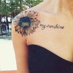 Most popular tags for this image include: tattoo, sunflower, flowers, sunshine and black