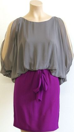 Dress with wing sleeves and fabric waist tie. Perfect statement dress for an event or night on the town. $59