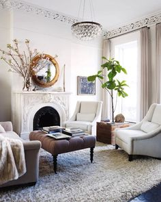 The high ceilings, gorgeous mouldings, fab fireplace and wonderful light.  Love it all.