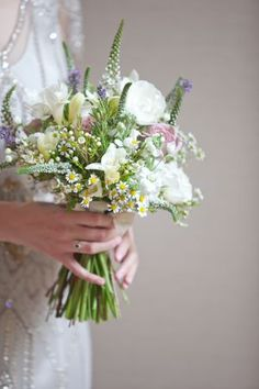 Natural hand tied bouquet. Like the daisies.